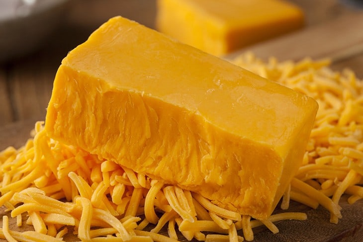 This image has an empty alt attribute; its file name is Cheddar-Cheese.jpg