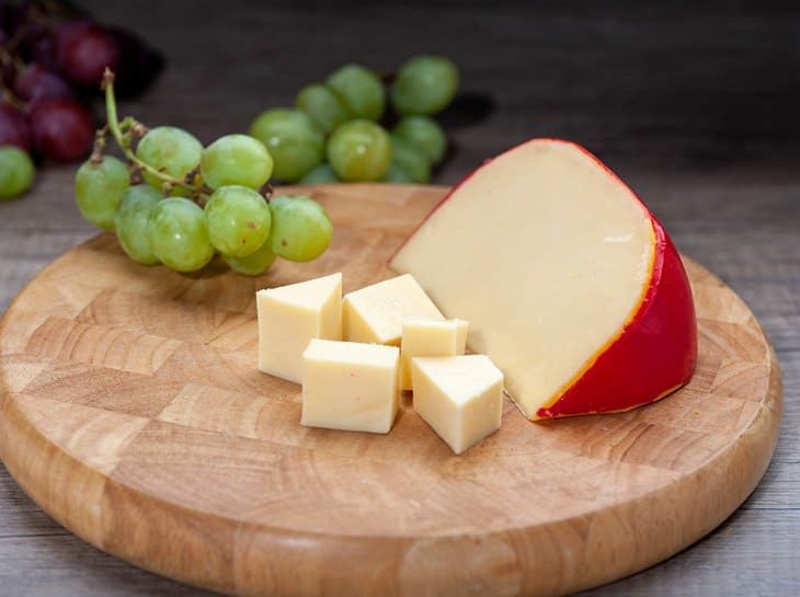 This image has an empty alt attribute; its file name is Edam-Cheese.jpg